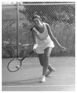 Debbie playing tennis in high school