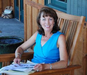Debbie Peek Sitting in Chair